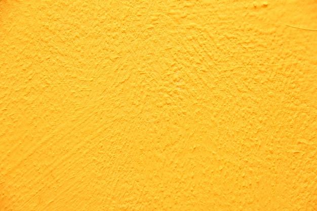 노란색 벽 텍스처입니다. 밝고 따뜻한 노란색 벽 배경입니다.