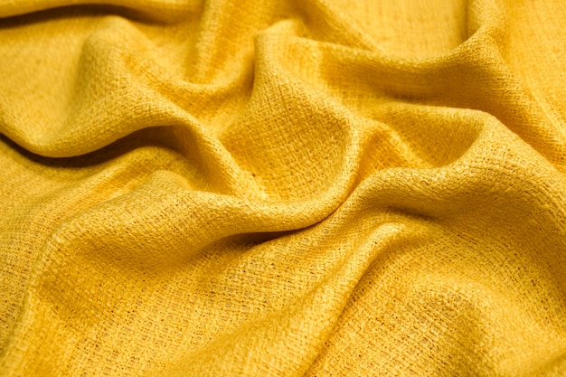 Yellow warm fabric texture material sweater on blur background
