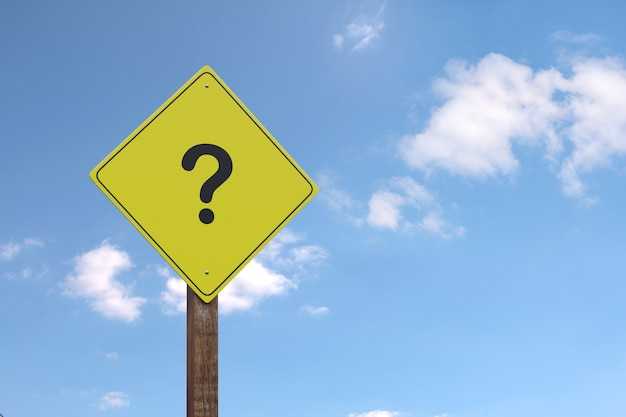 Yellow warning sign with question mark with copy space.