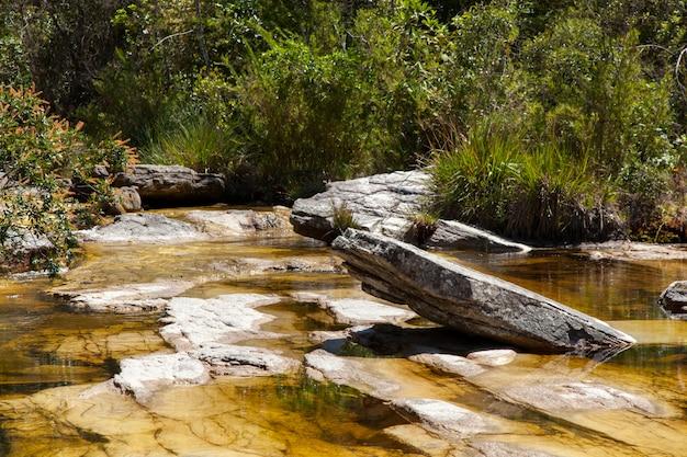 Yellow water river on quartzite rocks