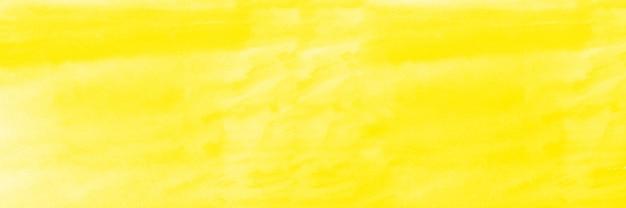 黄色の水彩画の背景、濡れた白い紙の背景に柔らかいテクスチャの水彩画、抽象的な黄色の水彩イラストバナー、壁紙