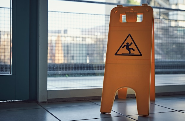Yellow wet floor warning sign