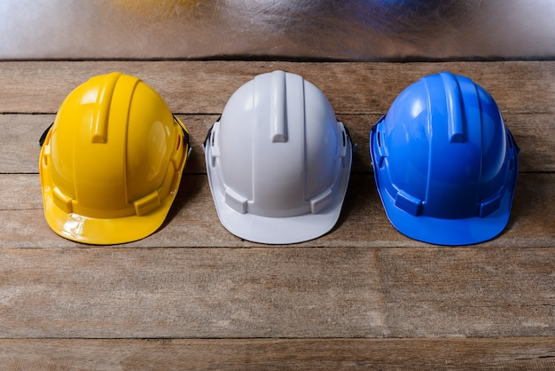 Yellow, white and blue protective safety helmet