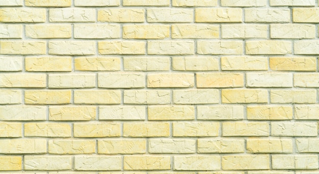 Yellow and white brick wall texture background with space for text. old bricks wallpaper. home interior decoration.