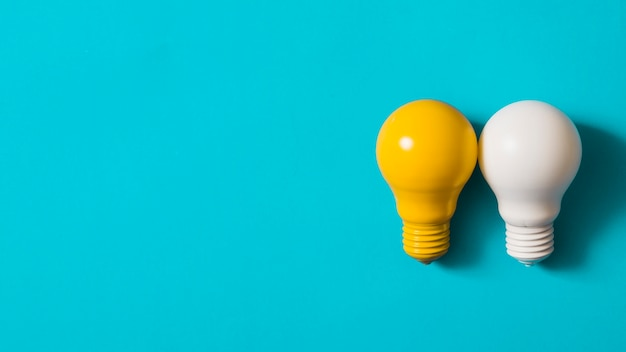 Yellow and white light bulb on blue background