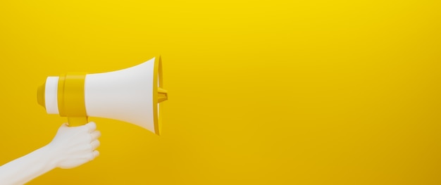 Yellow and white megaphone held by a white hand on yellow surface