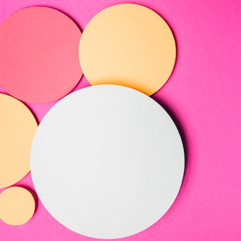 Yellow; white and red round paper circle frame on pink background