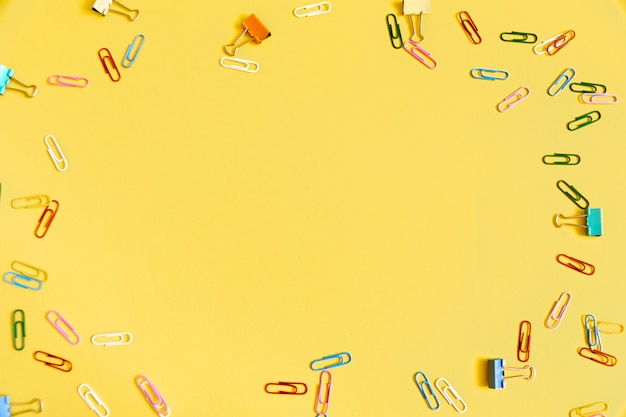 Yellow with colorful clips. frame for text in the centre.
