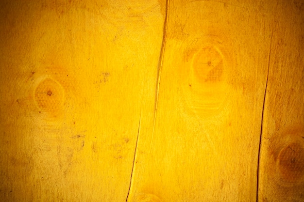 Yellow wooden board background.