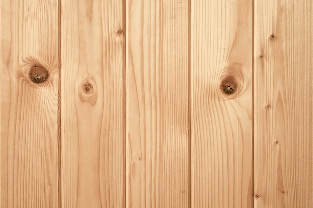 黄色の木の板、結び目、テクスチャと光の木の板。デスクパターン、天然木材の背景。