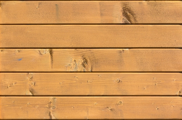 Yellow wooden plank wall texture for usage as background