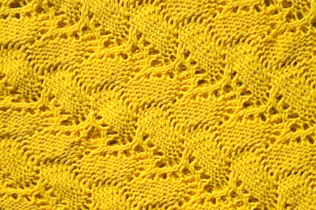 Yellow wool texture as fabric and textile background knitted wool fabric abstract pattern