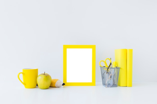 Yellow writing accessories for studies on white workplace