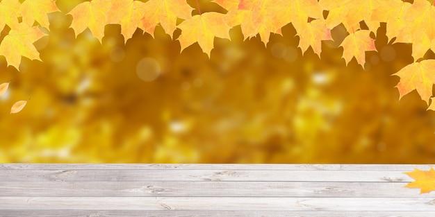 秋の自然と木製のテーブルバナー形式を背景に黄橙色のカエデの葉