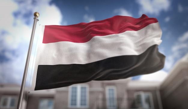 Yemen flag 3d rendering on blue sky building background