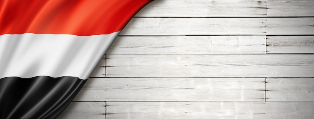 Yemen flag on old white wall