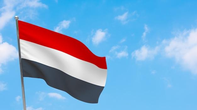Yemen flag on pole. blue sky. national flag of yemen