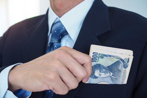 Yen notes in a businessman's pocket