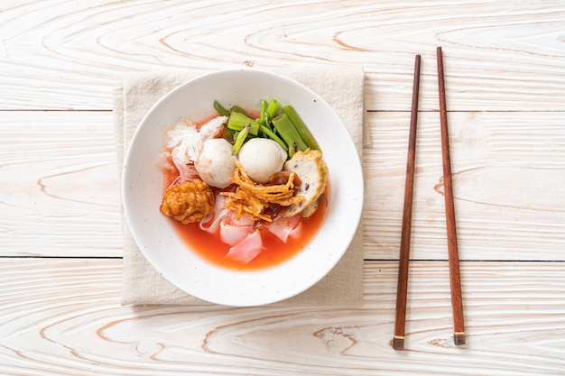 (yen-ta-four), thai style noodle with assorted tofu and fish ball in red soup, asian food style