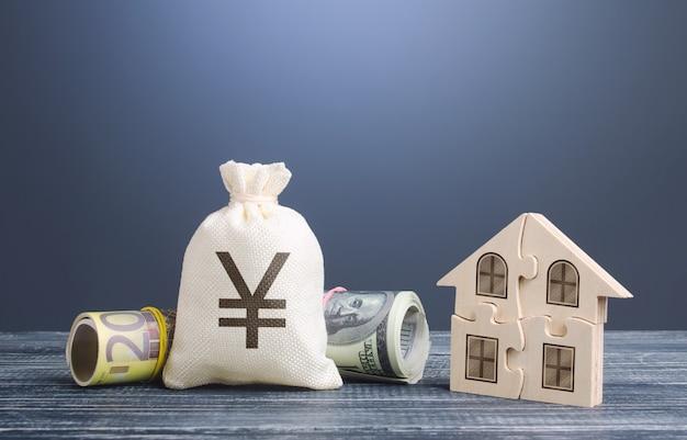円記号のお金の袋とパズルの家。