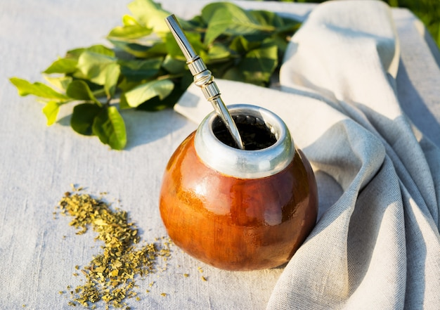 Yerba mate in gourd calabash with bombilla