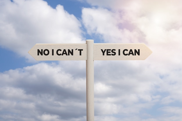 Yes i can concept. wooden sign post with text isolated on sky