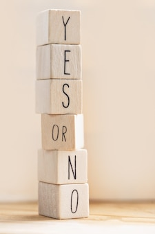Yes versus no inscription on wooden cubes and question