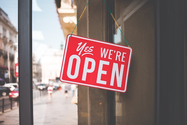Yes we're open sign on the glass of the doors in store.
