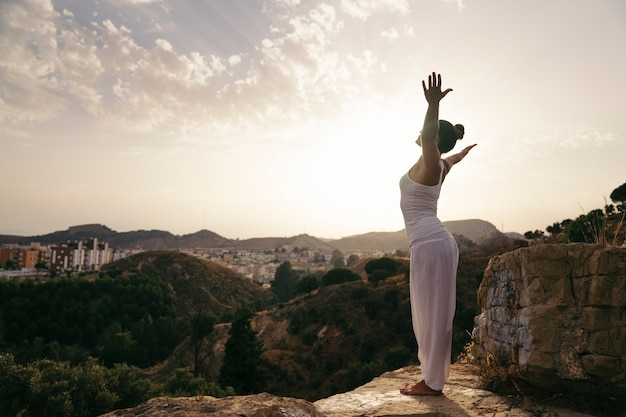 Yoga, countyside and sunset