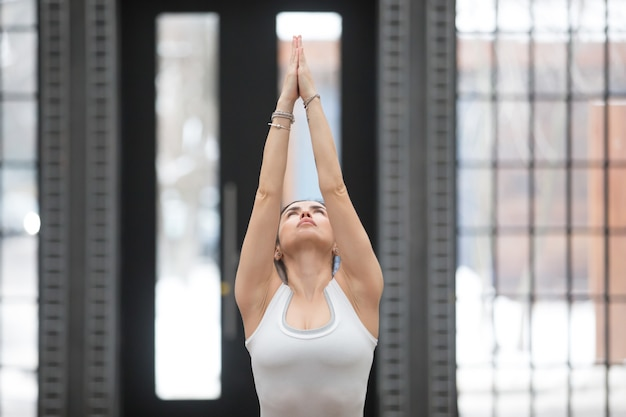 Yoga in fitness center: variation of tadasana pose