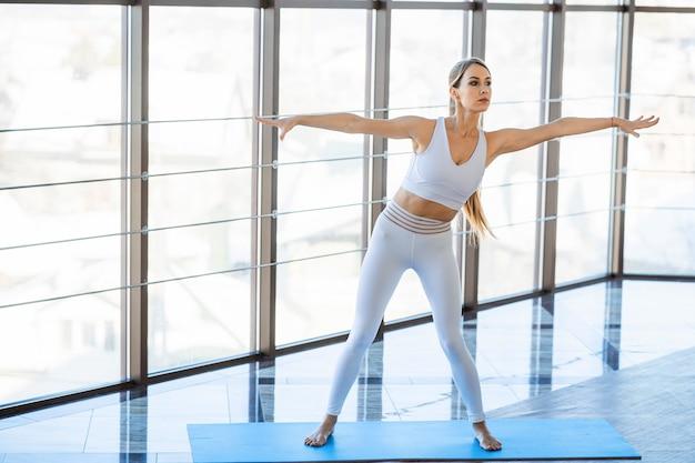 Yoga girl doing sports indoors