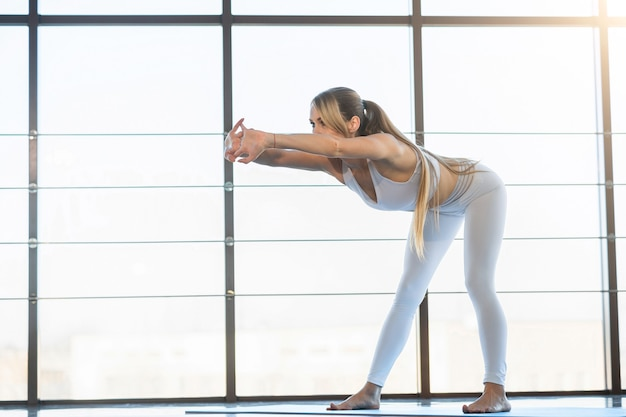 Yoga girl stretching and warming up
