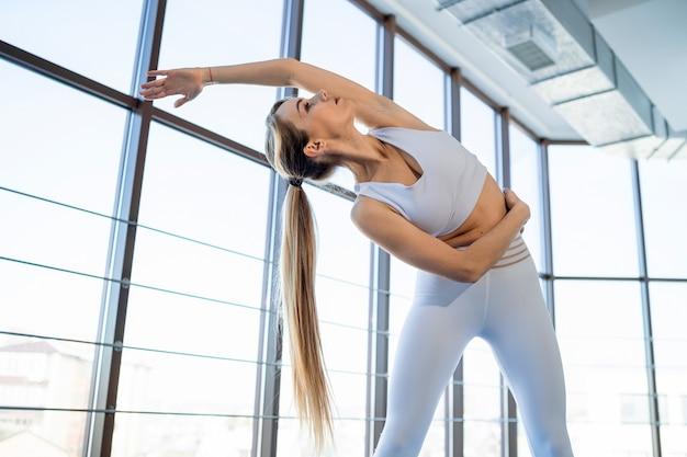 Yoga girl warming up before exercises