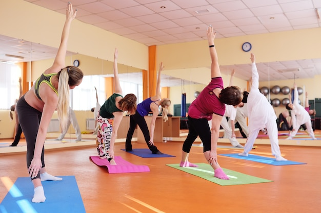Yoga group performs asanas