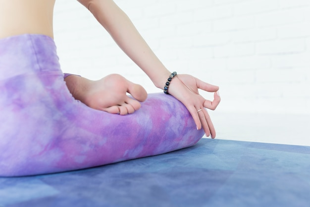 Yoga hands and feet of a young woman, practicing yoga