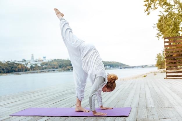Yoga instructor. female yogi practising balancing yoga asana