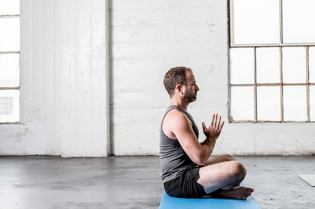 Yoga instructor teaching how to meditate to class
