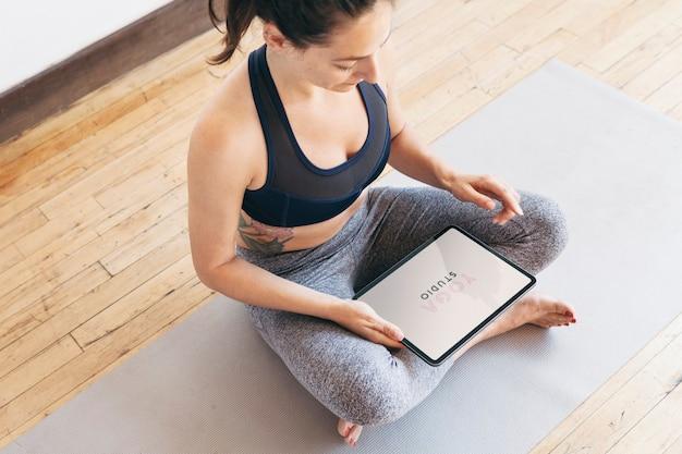 Yoga instructor using a digital tablet mobile phone wallpaper