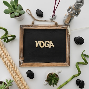 Yoga lettering on chalkboard