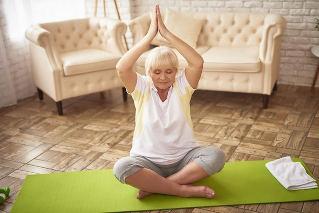 Yoga posture exercise senior lady stress relief.