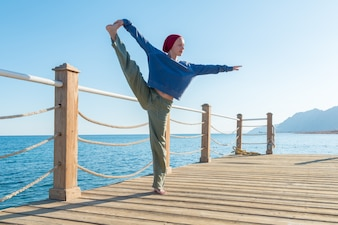 Yoga practice at the pier
