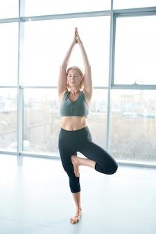 Yoga practice. woman doing balancing yoga