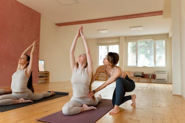 Yoga teacher at class teaching attendants