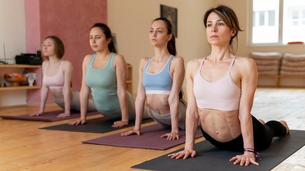 Yoga teacher teaching class