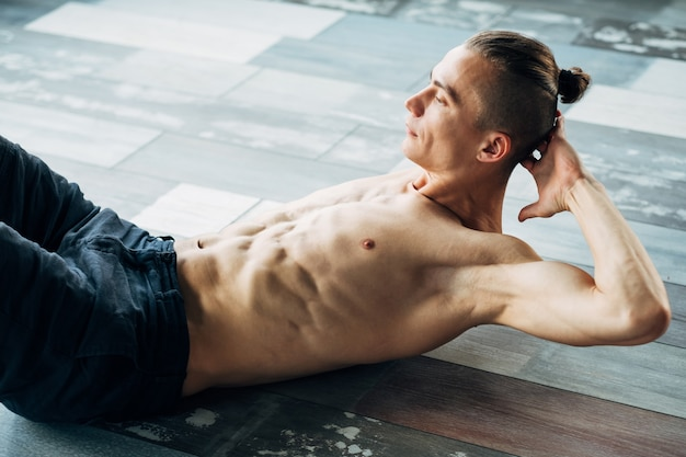Yoga training for strong and toned muscles. healthy and fit man's body. abs perfection. sport wellness and athletic lifestyle.