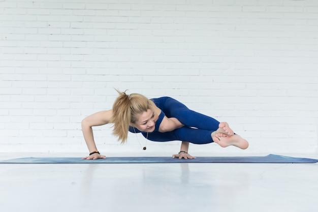 Yoga woman training on exercise mat