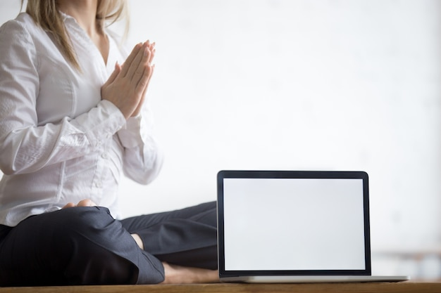 Yogi businesswoman with copy space laptop