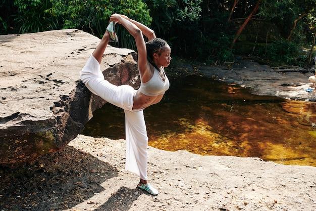 Yogi doing stretching exercise