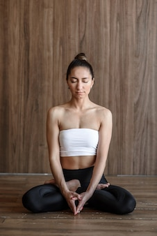 Yogi woman meditating in lotus position practicing yoga