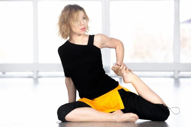 Yogi woman preparing for yoga asana eka pada rajakapotasana